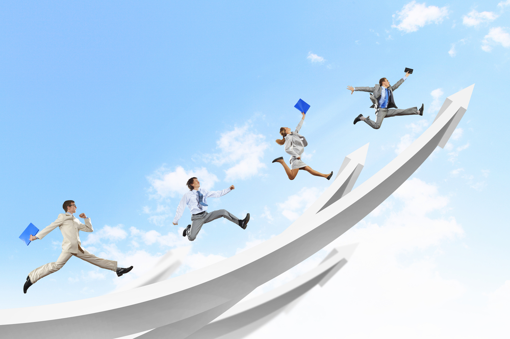 Young businesspeople jumping on white arrows. Growth concept